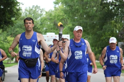 Chip Simpson (right) is one of several Delaware officers who have had the honor of participating in the Final Leg at a USA or World Games.