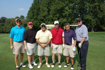 A unique feature of the Golf Classic is a Special Olympics golfer (Alex Sklar in red vest) playing three holes with each foursome.