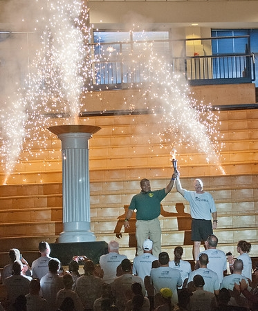 Corp. Chris Popp (Delaware State Police) and David Hill (Outstanding Athlete) celebrate the lighting of the cauldron.