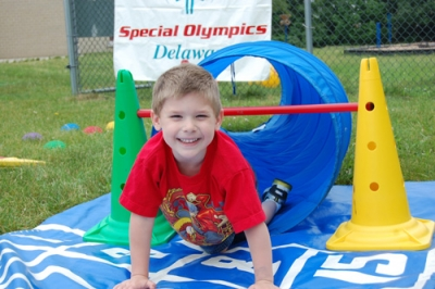 Young Athletes (ages 2-7) improve coordination and motor skills in preparation for the traditional Special Olympics program beginning at age
