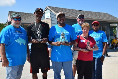 Left to right: Bruce West, Terry Downing (1st fish), Reggie Miller (most fish), Suzanne Schaible (largest), Tim Wallace and Janie Miller.